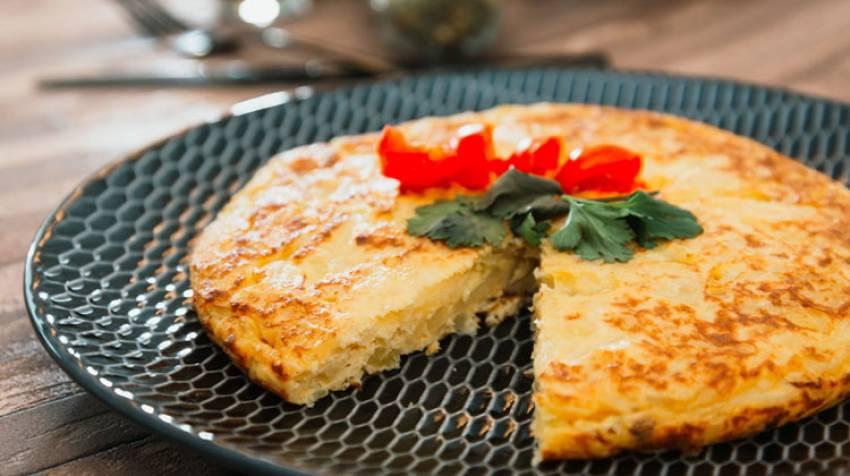Milhojas de patata con queso y especias